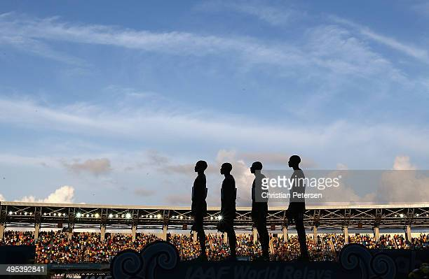 Collins Cheboi, Silas Kiplagat, James Kiplagat Magut and Asbel Kiprop of Kenya stand attended for the National Anthem on the podium after winning and...