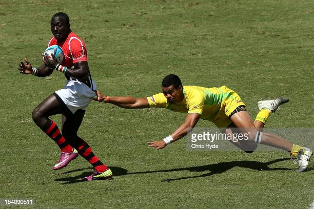 Collins Injera of Kenya is tackled by Pama Fou of Australia during the match between Australia and Kenya on day two of the 2012 Gold Coast Sevens at...