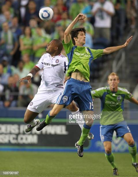 Collins John of the Chicago Fire heads the ball against Alvaro Fernandez of the Seattle Sounders FC on August 28 2010 at Qwest Field in Seattle...