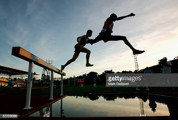 Collins Kosgei of Kenya jumps the water steeple during the Mens 3000 metres steeplechase during the Athletics Australia Telstra A-series meet at...