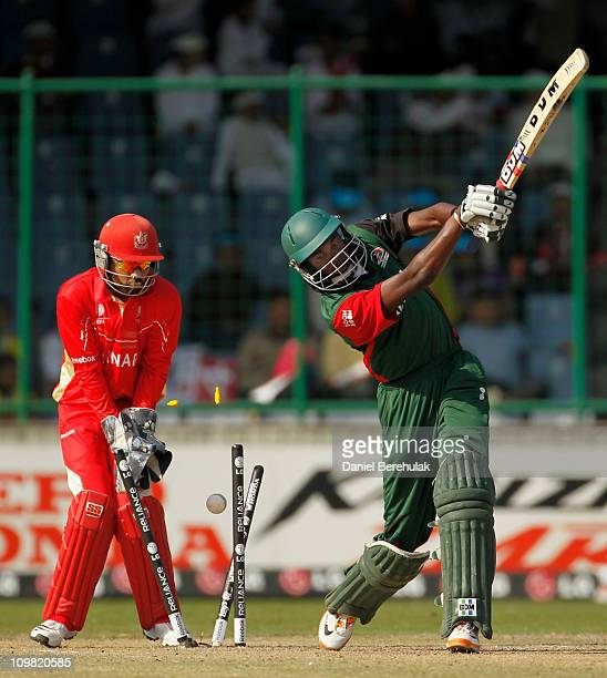 Collins Obuya of Kenya bats is bowled by Harvir Baidwan of Canada during the ICC Cricket World Cup group A match between Canada and Kenya at Feroz...