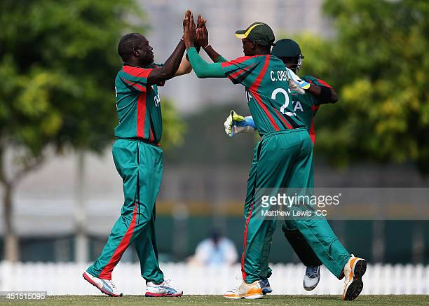 Collins Obuya of Kenya congratulates Steve Tikolo on bowling Ben Cooper of the Netherlands for LBW during the ICC World Twenty20 Qualifier between...