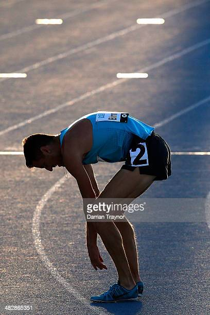 Collis Birmingham recovers after winning the mens 5000m final during the 92nd Australian Athletics Championships at Olympic Park on April 5 2014 in...