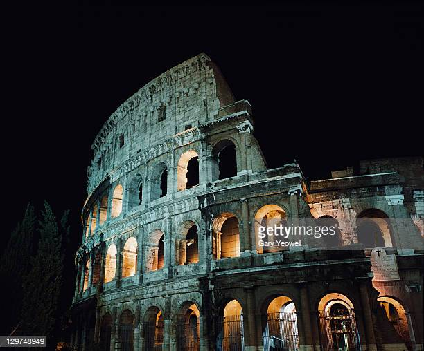 colloseum at night - yeowell stock pictures, royalty-free photos & images