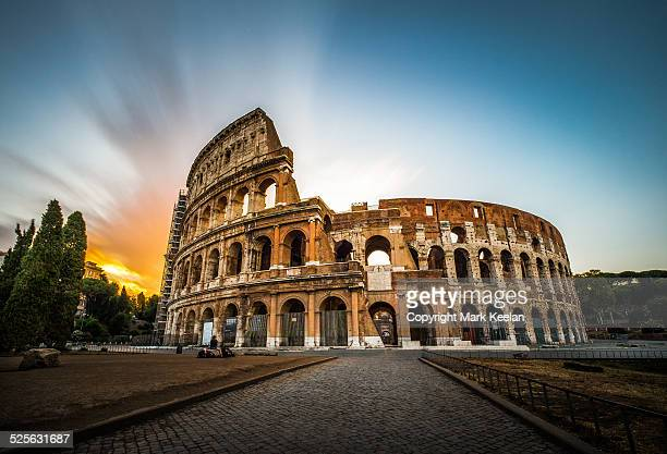 colloseum at sunrise - coliseum rome stock photos and pictures