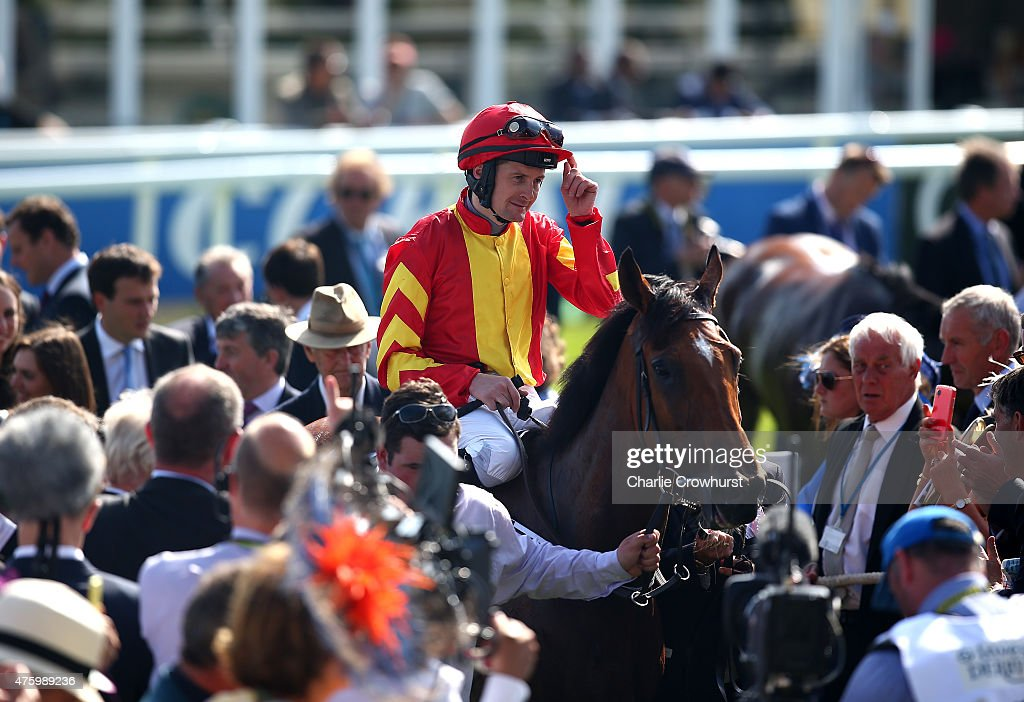 Colm O'Donoghue celebrates on Qualify after winning The Investec Oaks at Epsom racecourse on June 05, 2015 in Epsom, England.