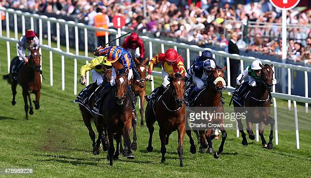 Colm O'Donoghue rides Qualify to win The Investec Oaks at Epsom racecourse on June 05 2015 in Epsom England