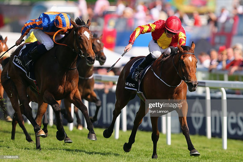 Colm O'Donoghue riding Qualify leads the field to victory in The Investec Oaks races during the Investec Ladies Day at Epsom Racecourse on June 5, 2015 in Epsom, England.