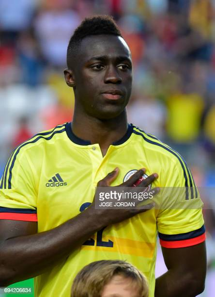 Colmbia's forward Davinson Sanchez listens to the national anthem during the friendly football match between Spain and Colombia at the new Condomina...