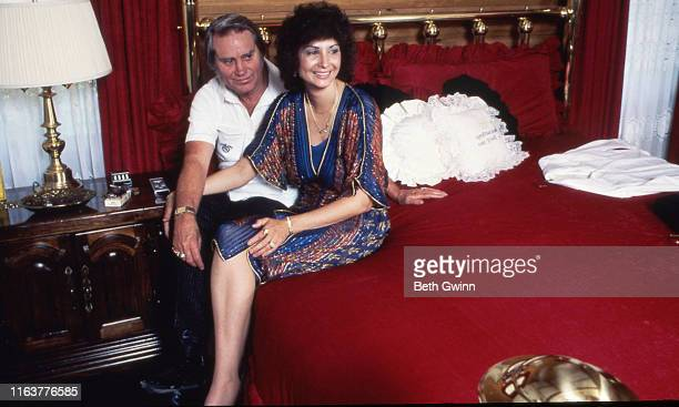 Country Music Singer Songwriter George Jones and Nancy Jones sit on bed in their home on January 1 1985 in ColmesneilTX