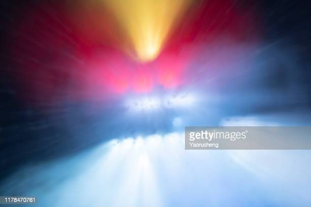 colofulr lighting explosion: orange,red and whtie - blood flow stock pictures, royalty-free photos & images