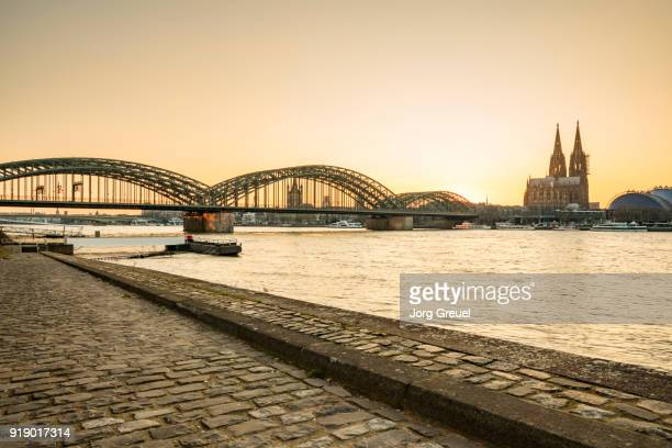 cologne at sunset - cologne stock pictures, royalty-free photos & images