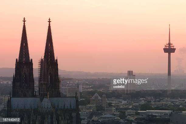 Cologne at sunset, skyline, orange sky, copy space