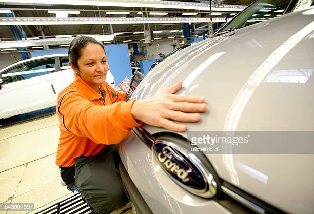 Cologne Body Assembly DEU GERMANY Car production at Ford in CologneNiehl a female worker is inspecting the body surface of Ford Fiesta car
