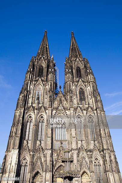 cologne cathedral aginst blue sky - cologne cathedral stock photos and pictures