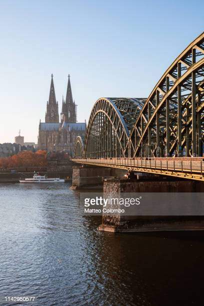 cologne cathedral and bridge at daytime, germany - cologne stock pictures, royalty-free photos & images