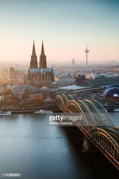 cologne cathedral and bridge at sunset, germany - cologne stock pictures, royalty-free photos & images