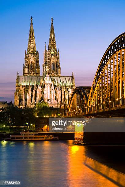 cologne cathedral and the hohenzollern bridge at twilight - cologne cathedral stock photos and pictures