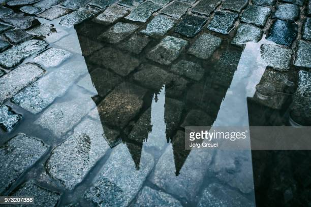 Cologne Cathedral reflected in a puddle