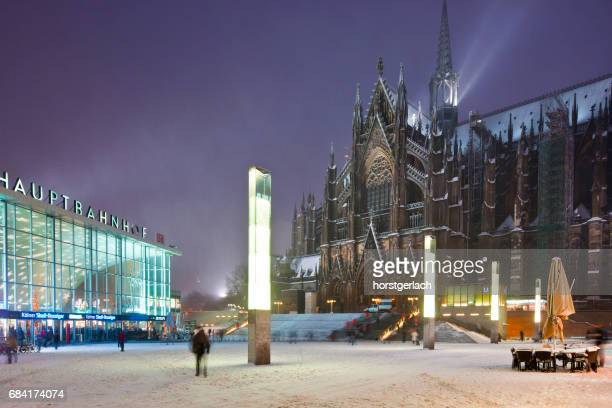 cologne central station and cologne cathedral in winter time - cologne cathedral stock photos and pictures