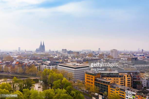cologne city center with cologne cathedral in the distance - cologne stock pictures, royalty-free photos & images