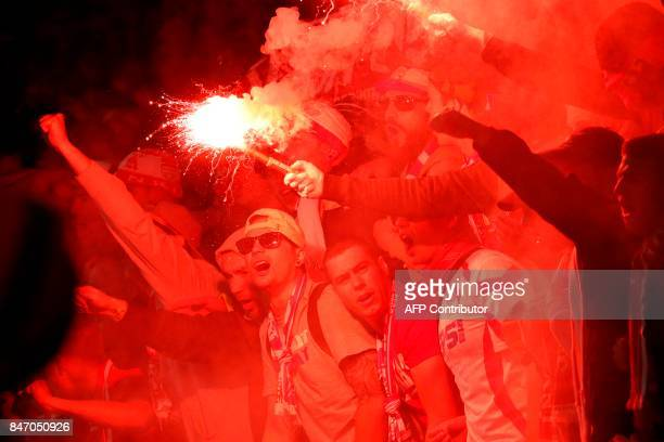 Cologne fans light flares inside the stadium during the UEFA Europa League Group H football match between Arsenal and FC Cologne at The Emirates...