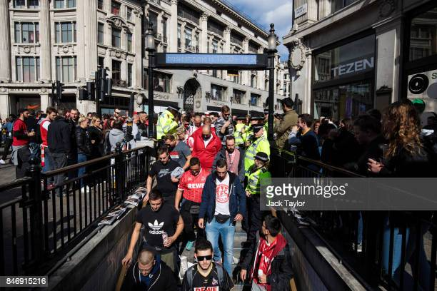 Cologne football fans make their way into Oxford Circus underground station ahead of the FC Koln match against Arsenal this evening on September 14...