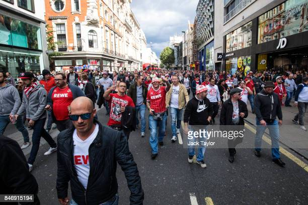Cologne football fans parade along Oxford Street ahead of the FC Koln match against Arsenal this evening on September 14 2017 in London England...