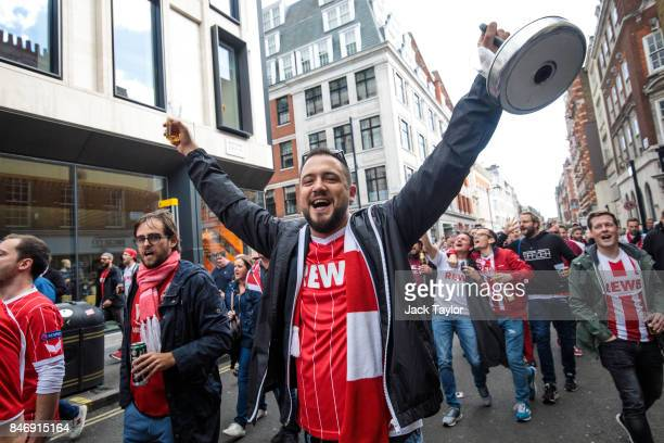 Cologne football fans parade through Soho ahead of the FC Koln match against Arsenal this evening on September 14 2017 in London England Arsenal take...