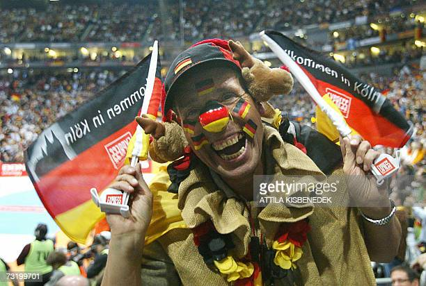 A Geman spectator celebrates a score for his team against Poland during their final match of the Men's Handball World Championship 04 February 2007...