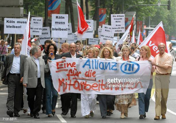 Employees of German insurance giant Allianz hold banners reading An alliance for the employees as they take part in a demonstration 28 June 2006 in...