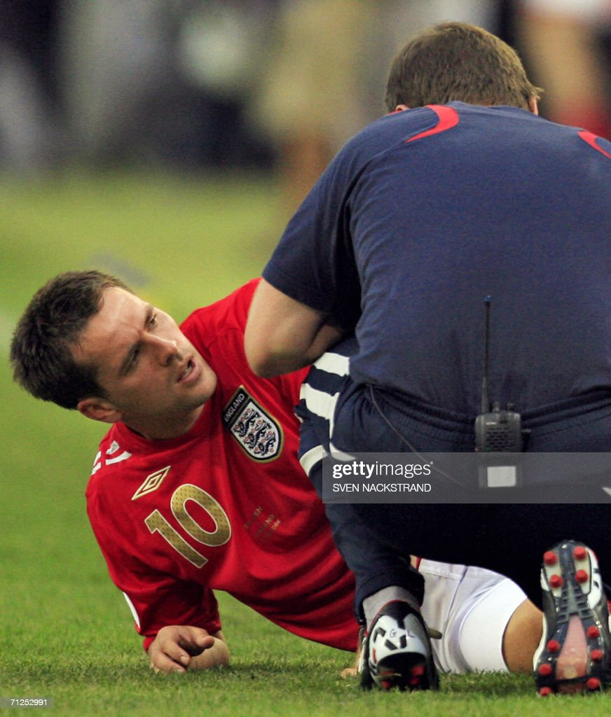 English forward Michael Owen is treated after being injured during the opening round Group B World Cup football match Sweden vs. England, 20 June 2006 in Cologne, Germany. The final score is 2 to 2.
