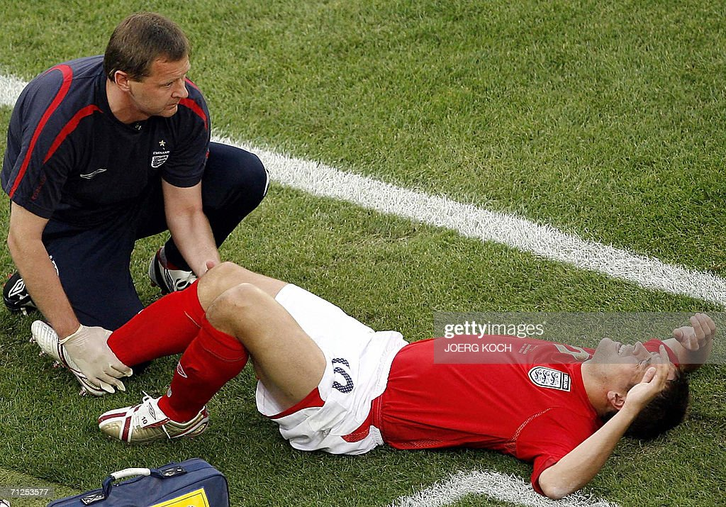 English forward Michael Owen is treated on the pitch after badly injuring his right knee uring the opening round Group B World Cup football match Sweden vs. England 20 June 2006 in Cologne. Michael Owen was ruled out of the World Cup 21 June 2006 after injuring his knee in the match against Sweden, the Football Association confirmed.