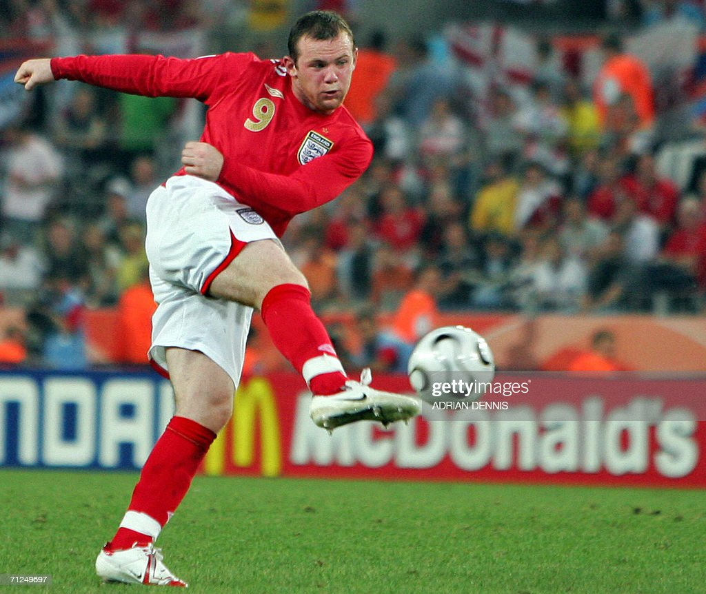 English forward Wayne Rooney shoots the ball during of the opening round Group B World Cup football match Sweden vs. England, 20 June 2006 in Cologne, Germany. The final score is 2 to 2.