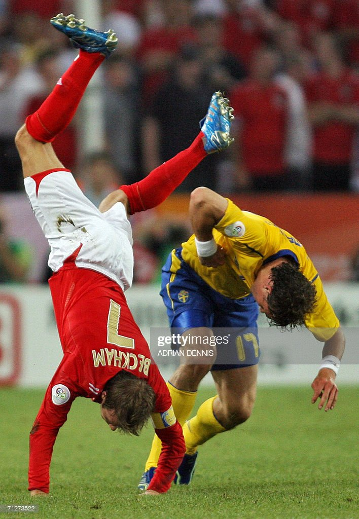 English midfielder David Beckham (L) falls down during the opening round Group B World Cup football match Sweden vs. England, 20 June 2006 in Cologne, Germany.