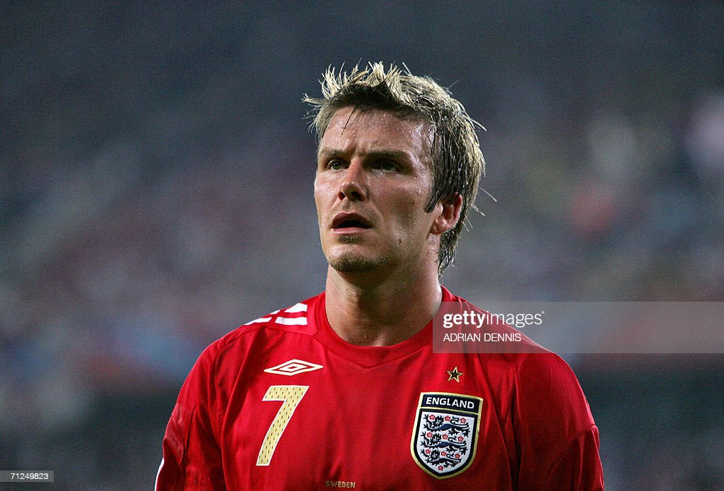 English midfielder David Beckham reacts during the opening round Group B World Cup football match Sweden vs. England, 20 June 2006 in Cologne, Germany. The final score is 2 to 2.
