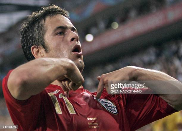 English midfielder Joe Cole celebrates after scoring during the opening round Group B World Cup football match Sweden vs England 20 June 2006 in...