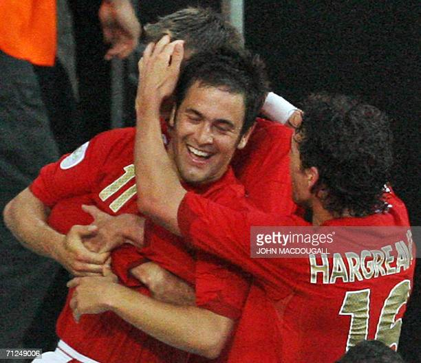 English midfielder Joe Cole is congratulated by teammates after scoring during the opening round Group B World Cup football match Sweden vs England...