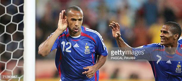 French forward Thierry Henry and French midfielder Florent Malouda jubilate after Henry scored during the World Cup 2006 group G football match Togo...