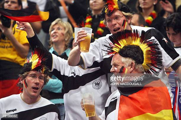 German beer drinking fans cheer prior to the Germany vs Poland final match of the 2007 Handball World Championship at the Koeln Arena in Cologne...