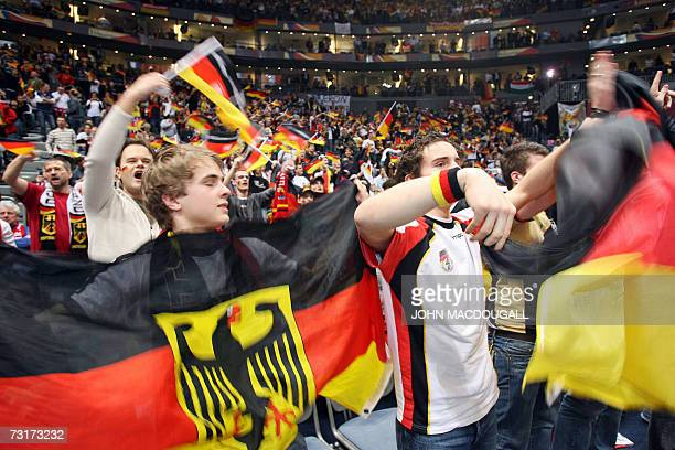 German fans wave flags prior to the Germany vs France semifinal match of the 2007 Handball World Championship at the Koeln Arena in Cologne western...