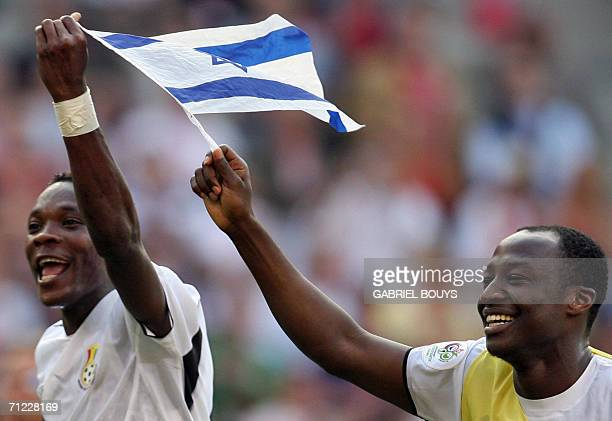 Ghanaian defender John Pantsil celebrates with a teammate with the Israelian flag after the 2006 World Cup Group E football match Czech Republic vs...