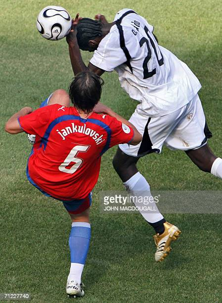 Ghanaian midfielder Otto Addo vies with Czech defender Marek Jankulovski during the 2006 World Cup Group E football match Czech Republic vs Ghana 17...