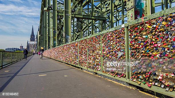 Cologne, people at the bridge of love padlocks