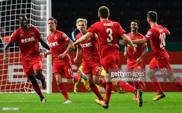 Cologne players celebrate after Cologne's German striker Simon Zoller scored the 01 goal during the German Cup football match Hertha Berlin v 1 FC...