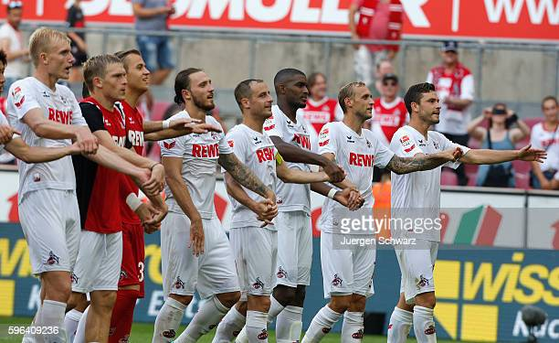 Cologne players celebrate in front of supporters after the Bundesliga match between 1 FC Koeln and SV Darmstadt 98 at RheinEnergieStadion on August...
