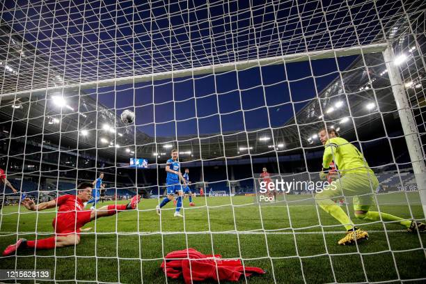 Cologne players concede the 02 goal during the Bundesliga match between TSG 1899 Hoffenheim and 1 FC Koeln at PreZeroArena on May 27 2020 in Sinsheim...