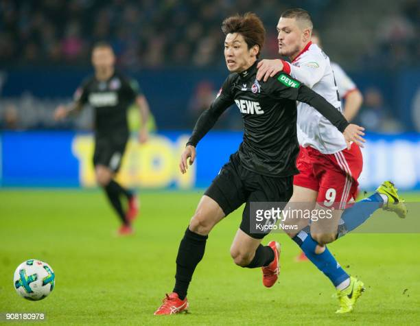 Cologne striker Yuya Osako tussles for the ball with Hamburg's Kyriakos Papadopoulos in the first half of Cologne's 20 win in the German first...
