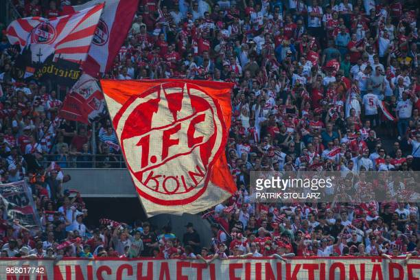 Cologne supporter wave flags during the German first division Bundesliga football match FC Cologne vs FC Bayern Munich in Cologne western Germany on...