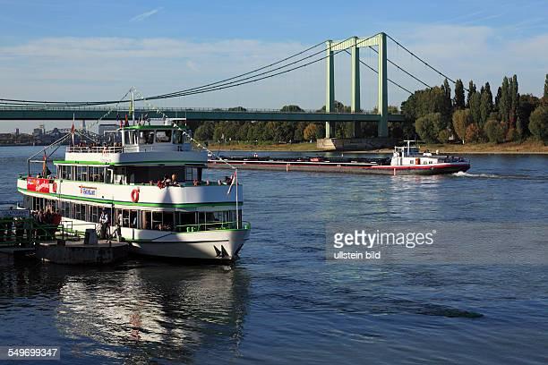 CologneRodenkirchen excursion ship at the Rhine bank cargo ship on the Rhine Rhine landscape Rhine bridge federal motorway A4